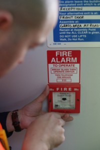 Fire Alarm Monitoring Services - Tech conducting testing at site
